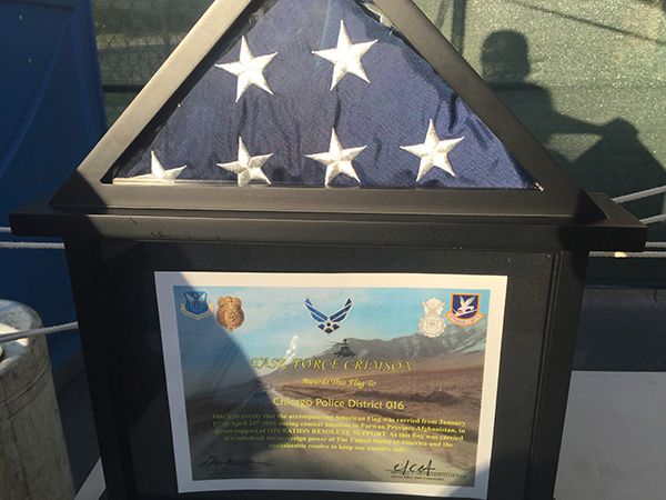 Flag carried in Afghanistan in Combat presented to Chicago's 16th District Police